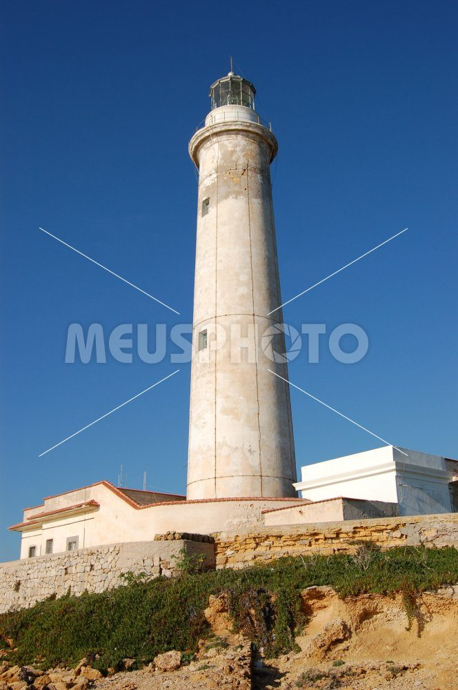Capo Granitola lighthouse on the cliff - MeusPhoto